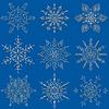 Векторный клипарт: Набор обращается силуэты снежинка