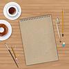 Arbeitsbereich mit Notizbuch und Kaffee