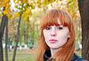 ID 4613178 | Całkiem czerwone włosy dziewczyna wygląda na aparat fotograficzny | Foto stockowe wysokiej rozdzielczości | KLIPARTO