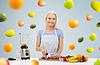 Smiling woman with blender preparing fruit shake | Stock Foto