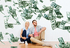 Happy couple at home over dollar money falling | Stock Foto