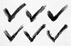 Schwarze Tinte Zeichnung Häkchen auf Aquarellpapier