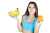 Athletic dziewczyna gospodarstwa owoców | Stock Foto