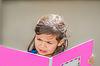 Little girl reading book | Stock Foto