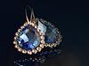 ID 4932147 | Gold ear rings against dark background | Foto stockowe wysokiej rozdzielczości | KLIPARTO