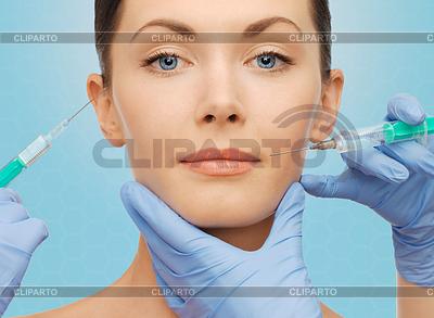 Frau Gesicht und Hände Chirurg mit Spritzen | Foto mit hoher Auflösung |ID 5159753