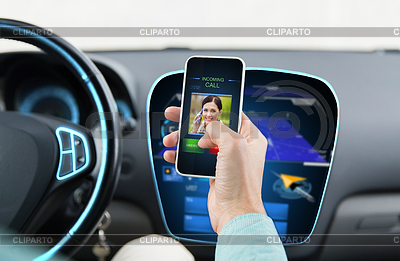 Man with call on smartphone in car | High resolution stock photo |ID 5406426