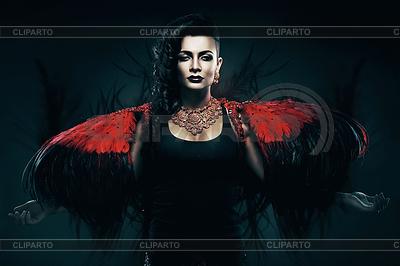 Transwestyta ze skrzydłami czarne i czerwone | Foto stockowe wysokiej rozdzielczości |ID 4770634